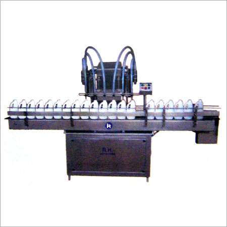 AUTOMATIC SIX HEAD LIQUID BOTTLE FILLING MACHINE