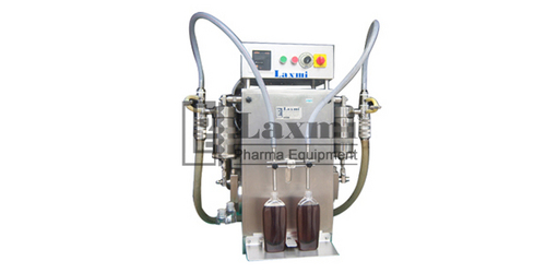 SEMI AUTOMATIC TWIN HEADS LIQUID FILLING MACHINE MODEL: SLF – 50N