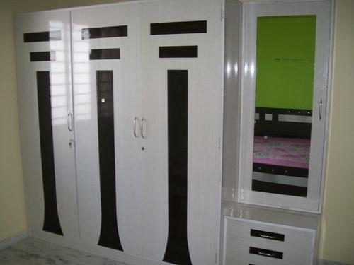 Fevicol sunmica designs for wardrobe doors for Sunmica door design