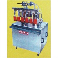 LINEAR VACUUM FILLING MACHINE