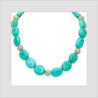 Necklace Strung with Gold Beads Studded with Turquoise