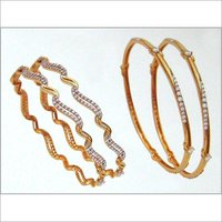DESIGNER GOLD BANGLES WITH STUDDED DIAMOND