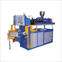 CONTINUOUS EXTRUSION TYPE MOULDING MACHINE