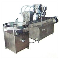 AUTOMATIC FOUR HEAD FILLING & SINGLE HEAD ROPP CAP SEALING MONOBLOCK MACHINE