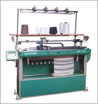 SEMI COMPUTERIZED FLAT BED KNITTING MACHINE