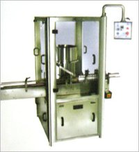 MEASURING CUP PLACING & PRESSING MACHINE