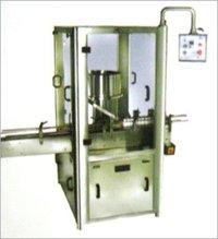 MEASURING CUP PLACING & PRESSING MACHINE