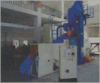 AIRLESS SHOT PEENING MACHINE