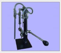 Hand / Manually Operated Volumetric Liquid Filling Machine