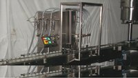 Automatic Liquid Bottle Filling Machine - Volumetric Principle