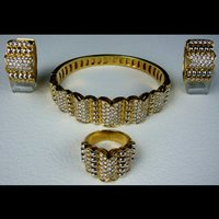 Diamond Bangle, Ring And Earrings Set In 18k Yellow Gold