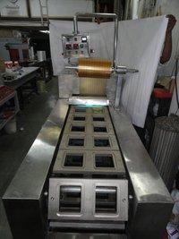 Automatic Tray Lidding Machine