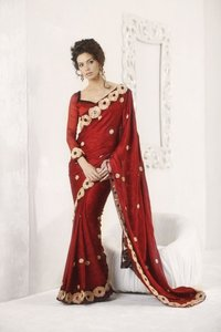 Tantalizing Brick Red Embroidered Saree