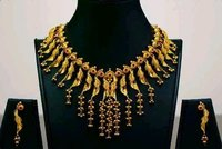 Artistic Gold Necklace Set