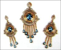 Sensuous Blue Topaz And Diamond Earrings With Pendent