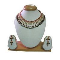 Gold Set Studded With Red And Green Beads