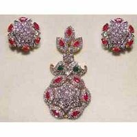 Diamond Pendants Sets with ruby and emb.