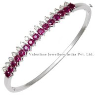 Diamond And Ruby Half Bangle Bracelet In White Gold Gemstone