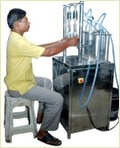Vacuum Type Bottle Filling Machinery