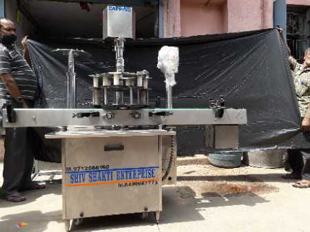 Automatic Single and Multi Head Ropp Cap Sealing Machine in  Ctm