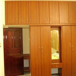 Modern wooden wardrobe in sanganoor coimbatore carve arts for Bedroom cupboard designs in hyderabad