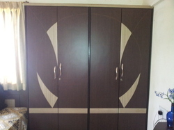 Bedroom wardrobe in ganesh nagar pune atharva kitchens interiors for Decolam designs for bedroom