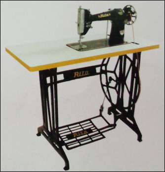 Umbrella With Stand Table Sewing Machine In Industrial Area