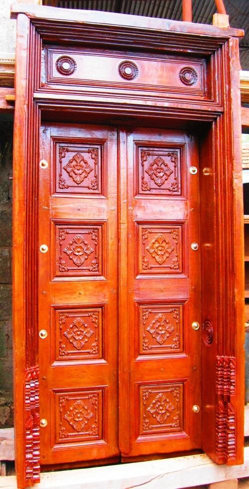 Attractive design door with door frame in gopalapuram for Main door frame designs