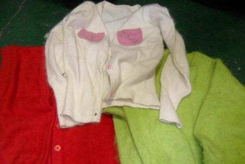 Uncutting Used Sweaters For Recycling