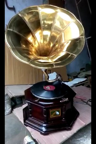 Old And New Gramophone And Clock
