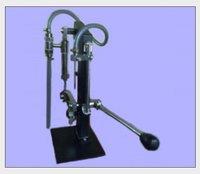 Hand / Manually Operated Volumetric Liquid Filling Machine