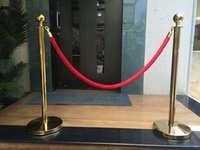 Que Managers with Red Velvet Rope