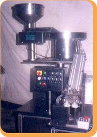 Machine For Counting And Filling Tablets Into Cardpack