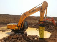 Excavator With Rock Breaker