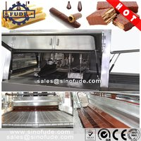 Chocolate enrobing machine with cooling tunnel<